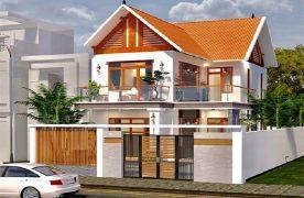 Căn nhà phố 2 tầng mái thái lợp ngói đỏ đồng bộ với màu chủ đạo. Vẻ hiện đại của ngôi nhà khiến chúng thêm phần bắt mắt.